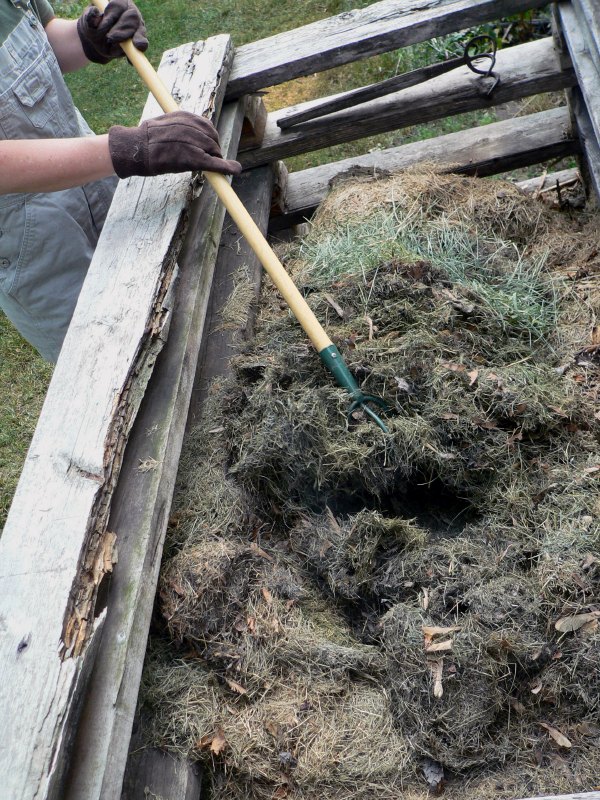 Manually turn small compost piles to increase oxygen content
