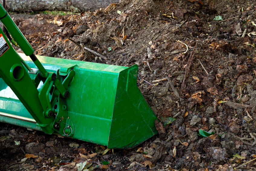 Turn larger compost piles with front-end loaders