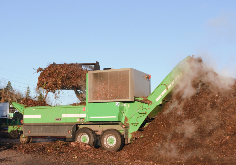 Mechanical grinders reduce particle size to aid decomposition of compostable materials
