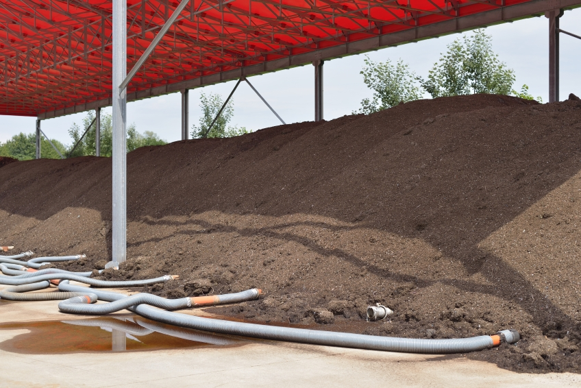 Aerate large compost piles with perforated pipes